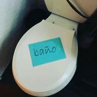 Sticky note on toilet seat